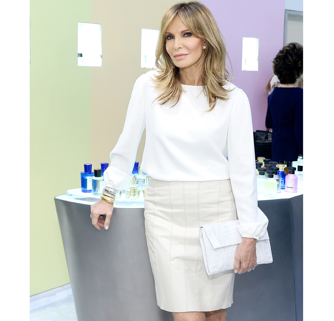 Jaclyn Smith wearing a white blouse.