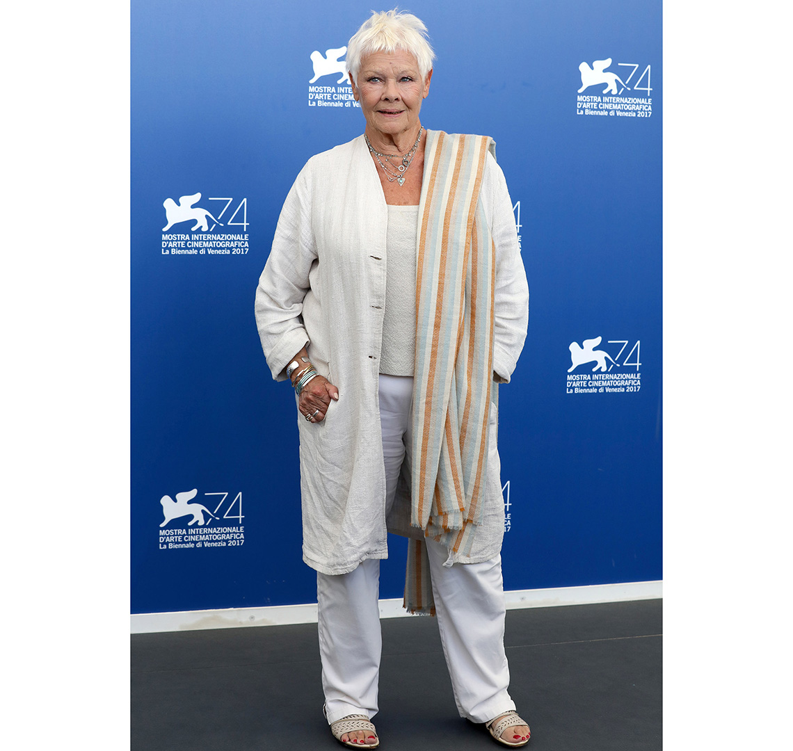 Judi Dench in a casual white duster.