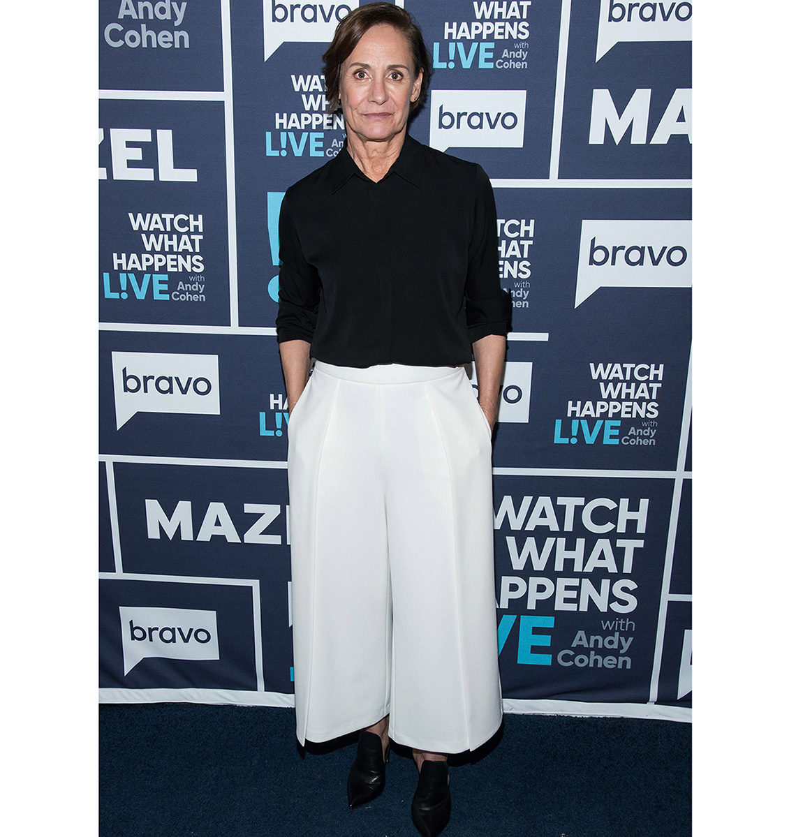 Laurie Metcalf wearing white wide pants.