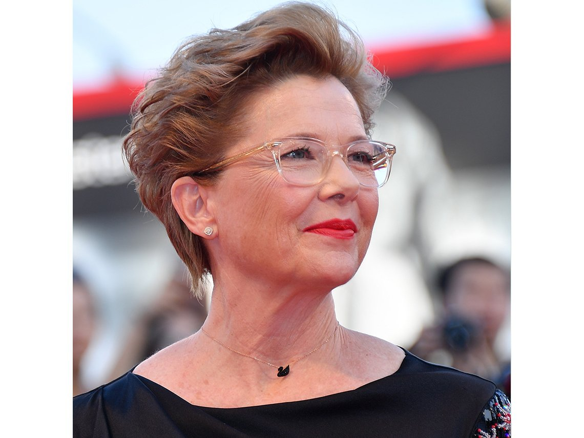 Actress Annette Bening wearing glasses with a light, clear frame