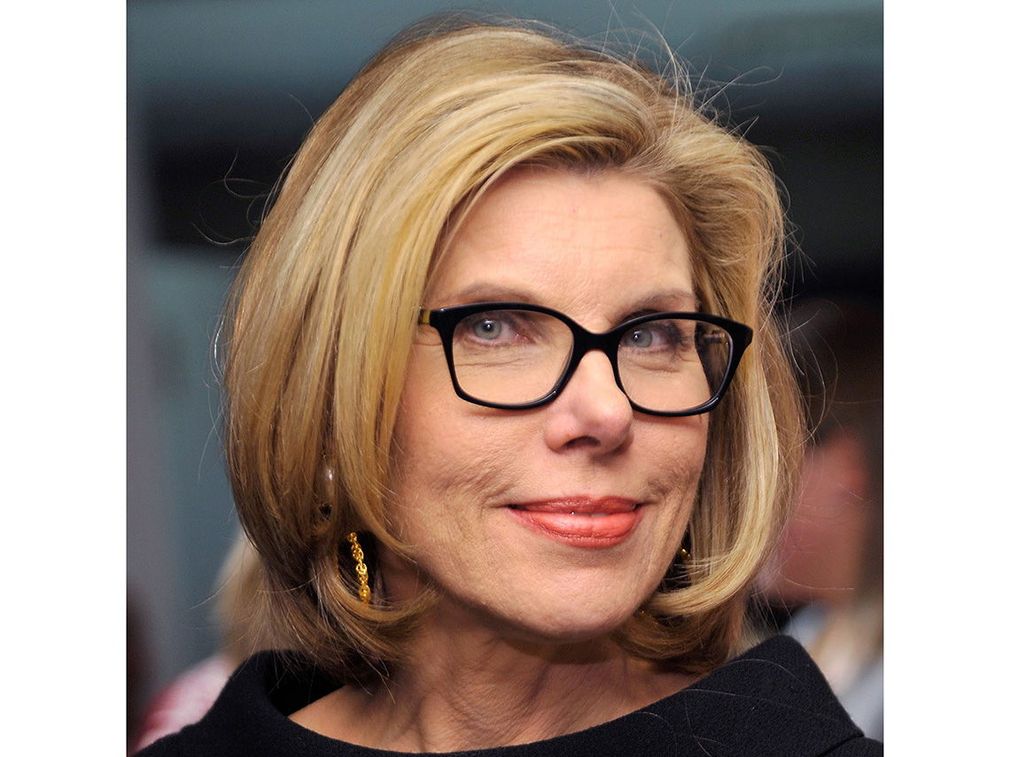 Christine Baranski wearing black rim glasses.