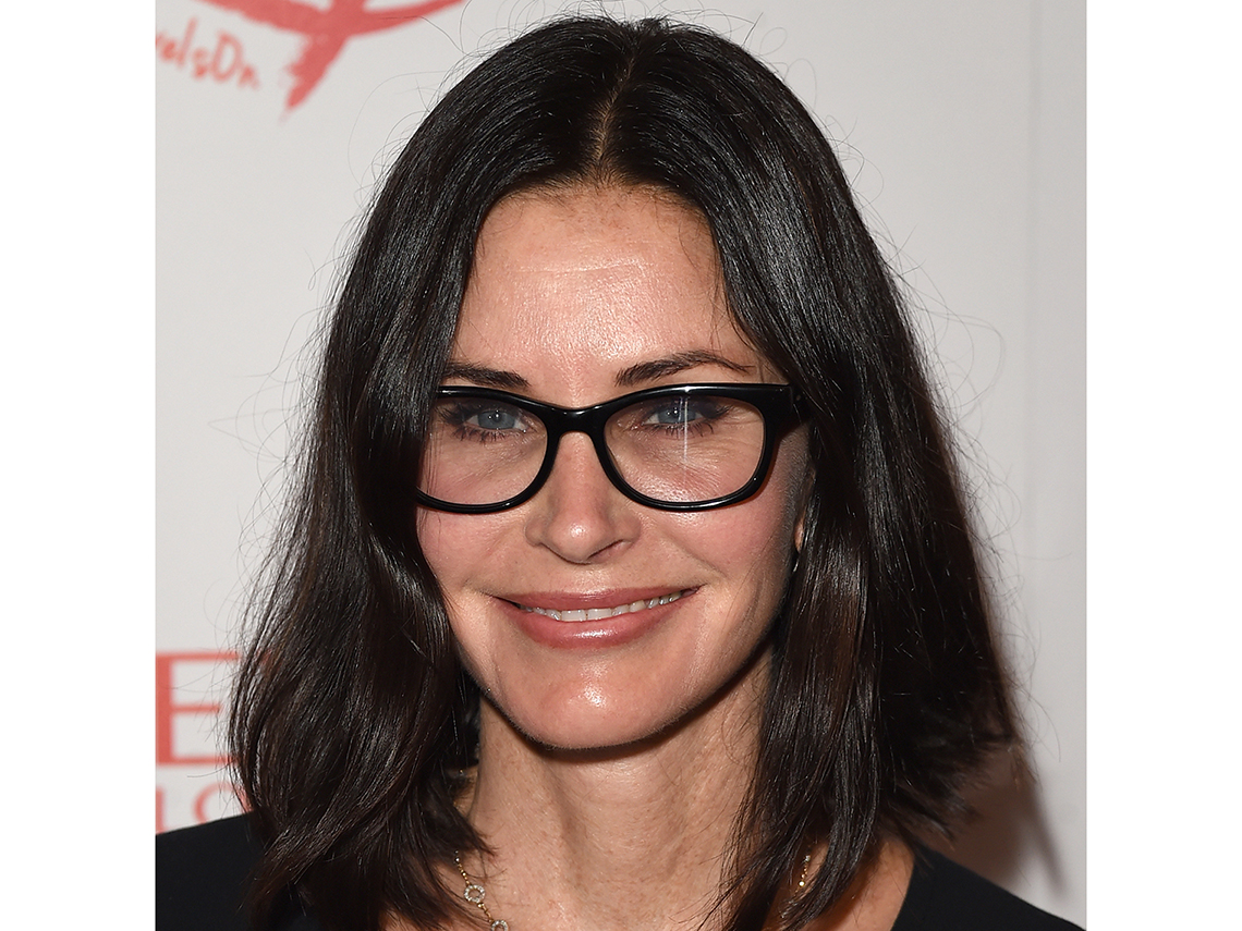 981466f5bea Courteney Cox wearing black frame glasses.
