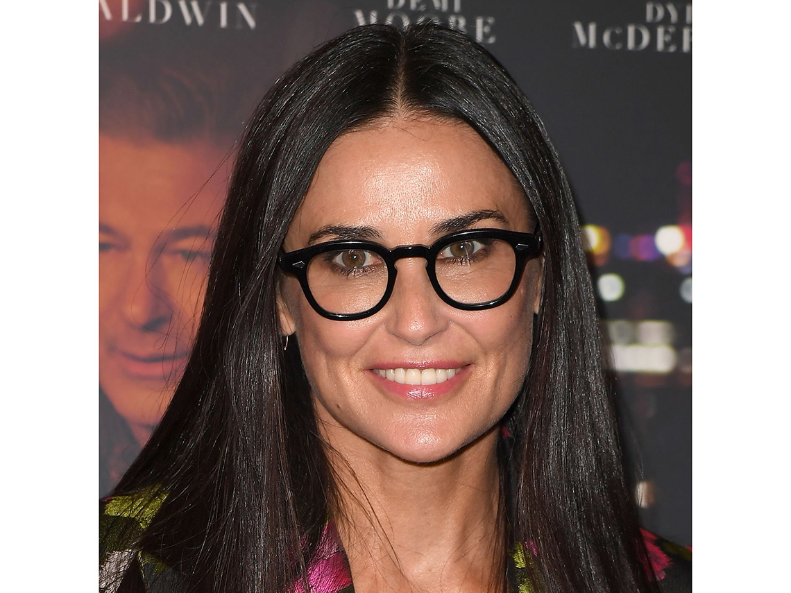af00976263 Demi Moore with black frame glasses.
