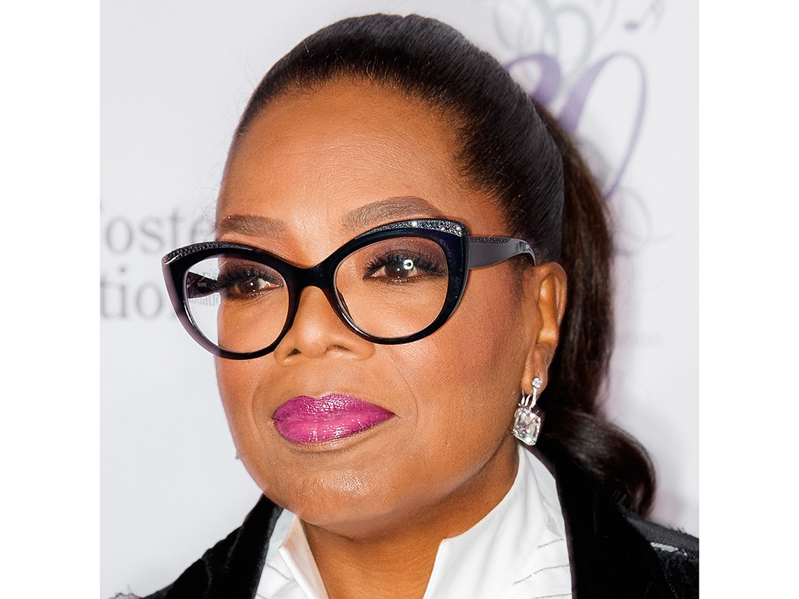 Oprah Winfrey wearing black frame glasses.