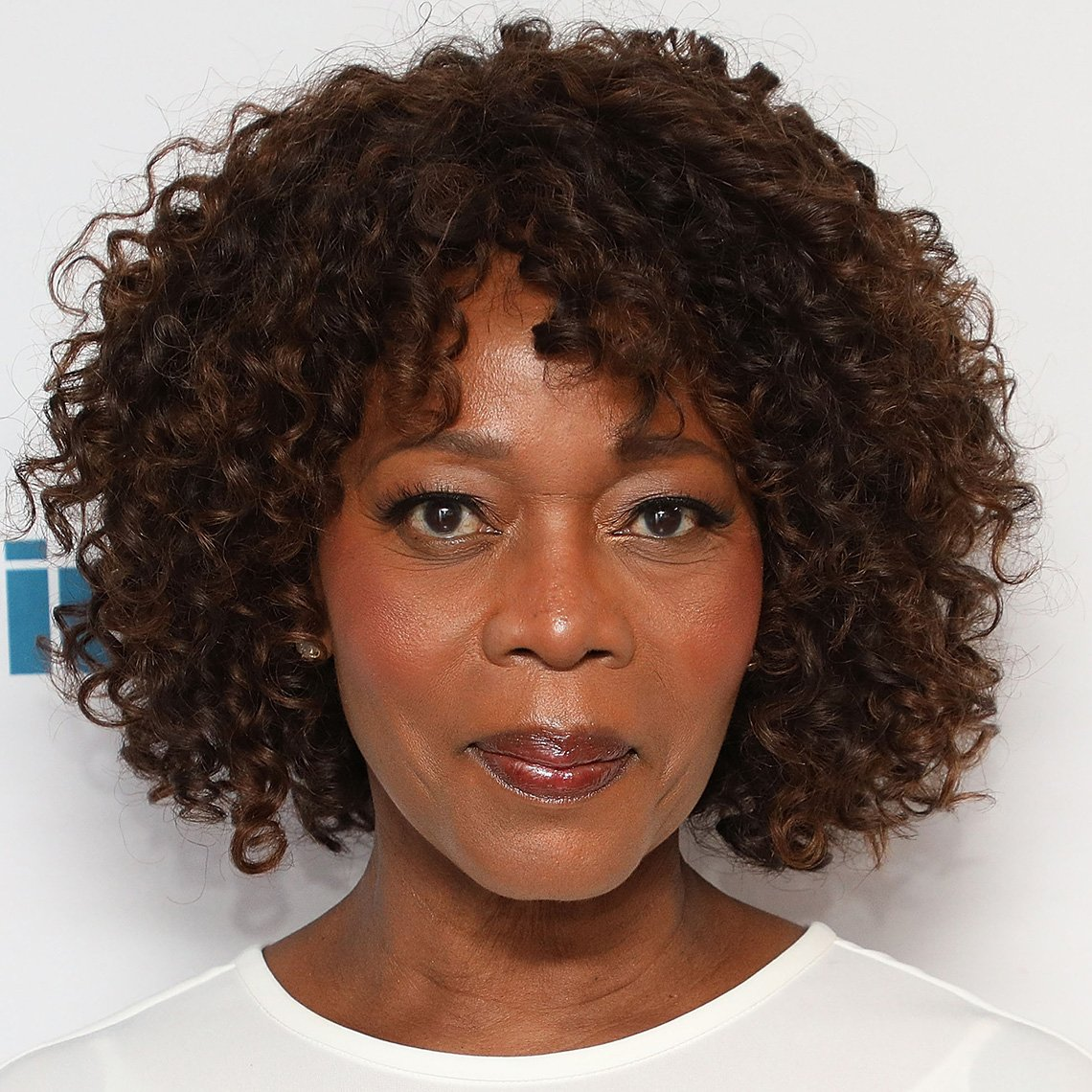 Alfre Woodard has a tightly textured ringlet bob