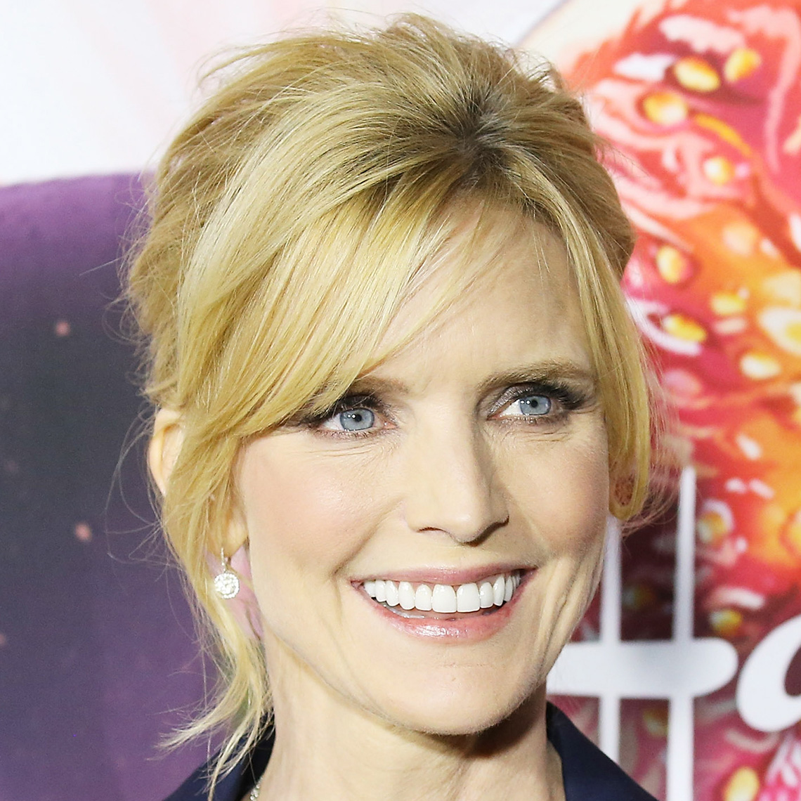 Courtney Thorne-Smith's updo with blonde side swept bangs