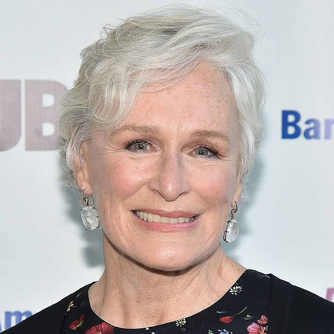 Glenn Close with a short wavy white crop hairdo
