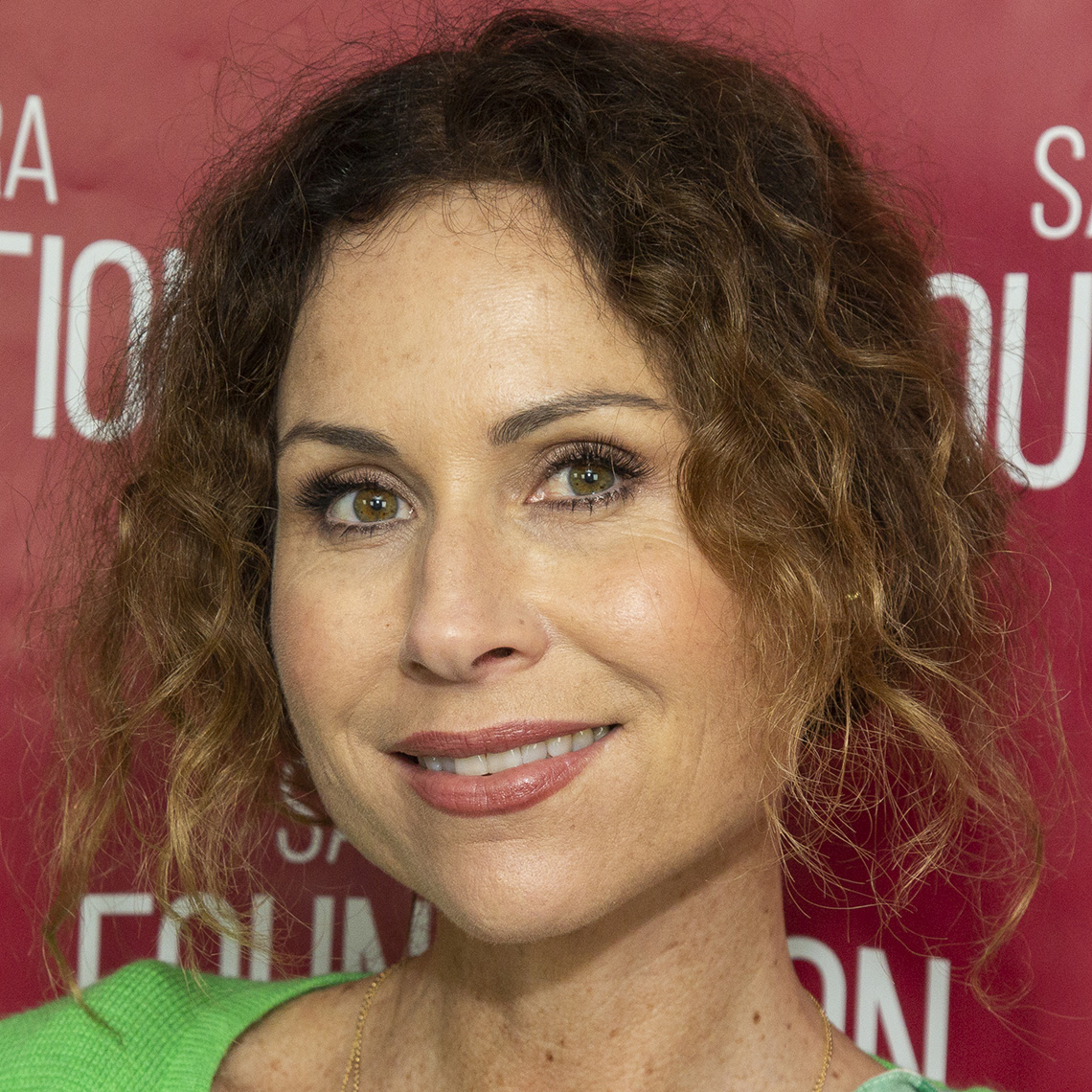 Minnie Driver's wavy highlighted hair looks perfect up or down.