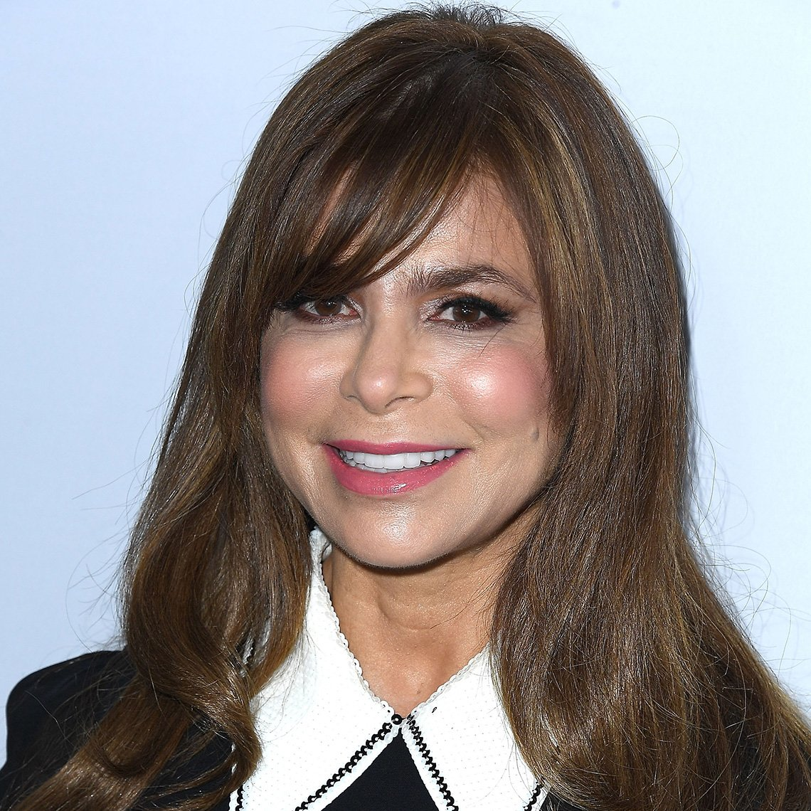 Paula Abdul with long brown hair and bangs