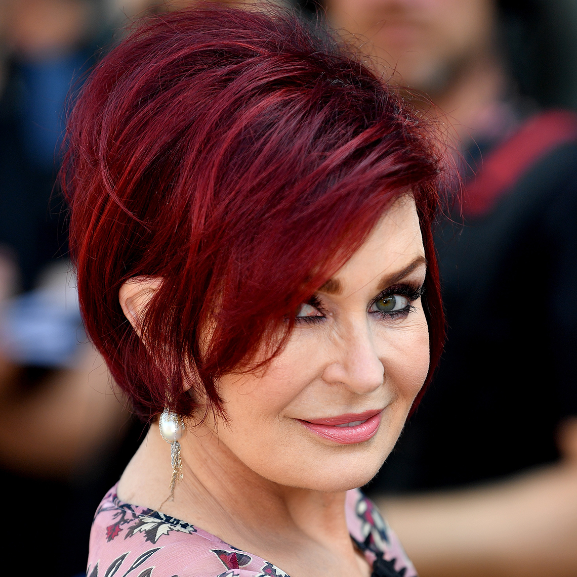 Sharon Osbourne makes a statement with her red dyed hair.