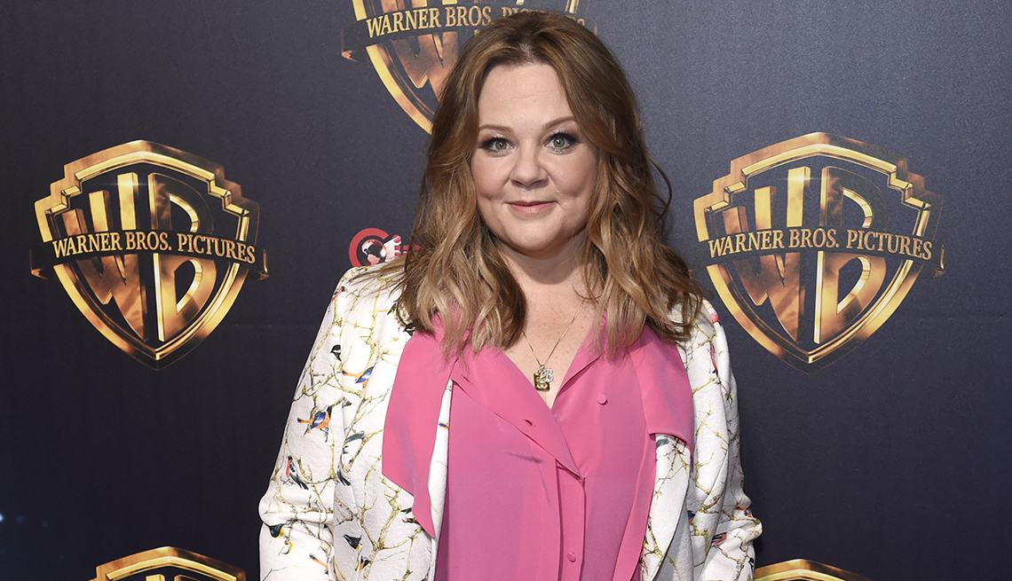 Actress Melissa McCarthy in a pink shirt and floral blazer