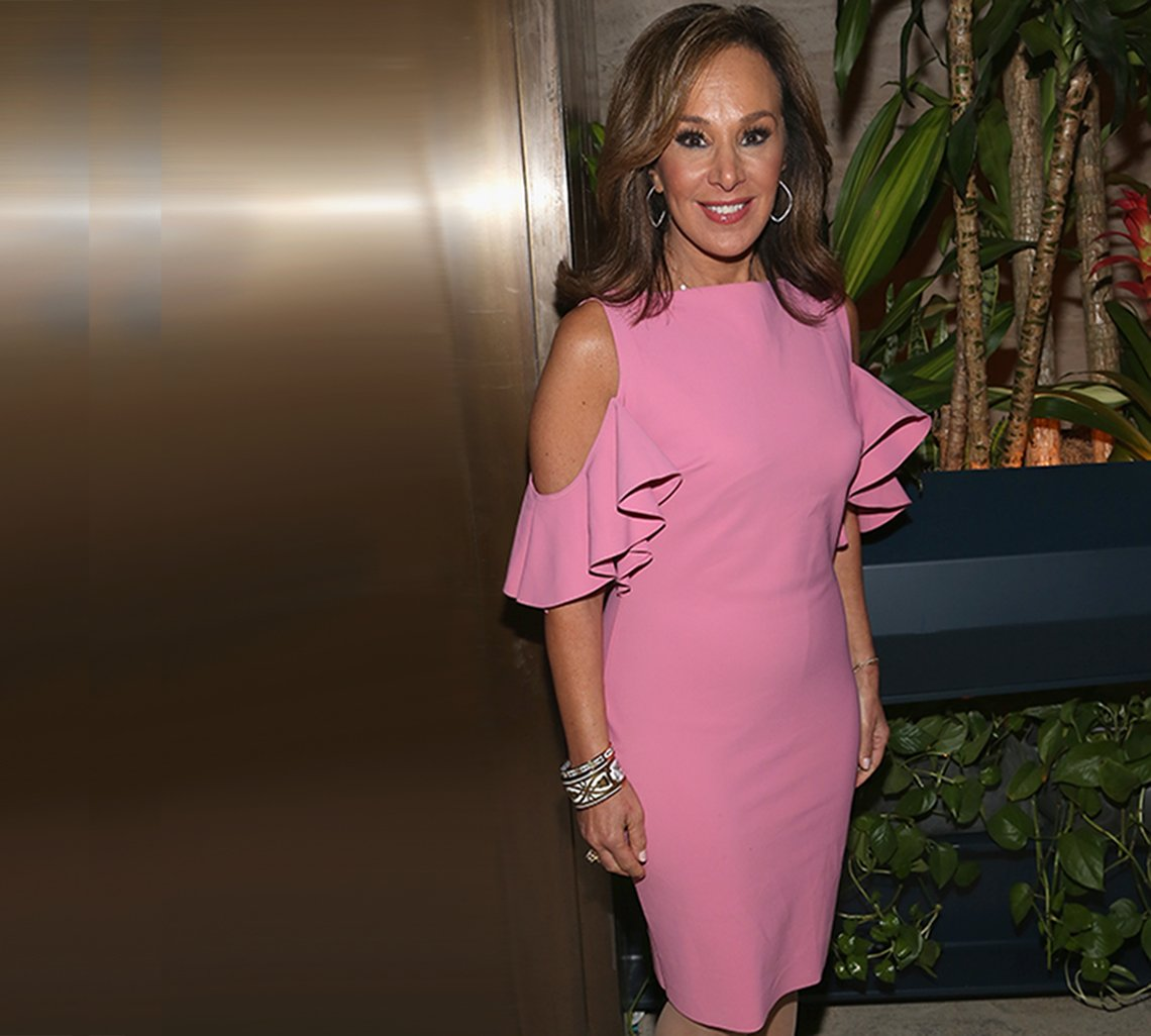 Rosanna Scotto in a pink sheath with cold-shoulder elbow-length ruffled sleeves.