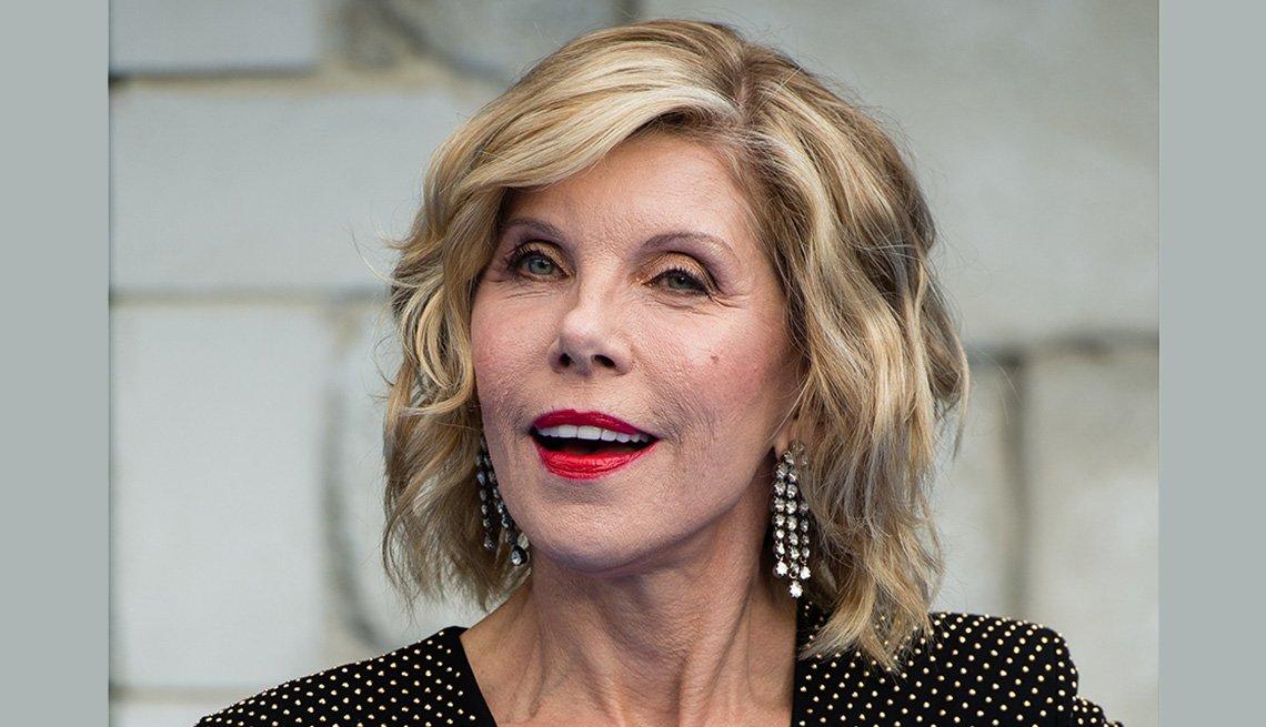 item 9 of Gallery image - Christine Baranski maintains blonde looking hair.