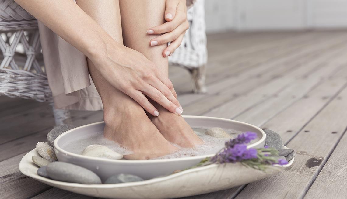 woman with feet soaking
