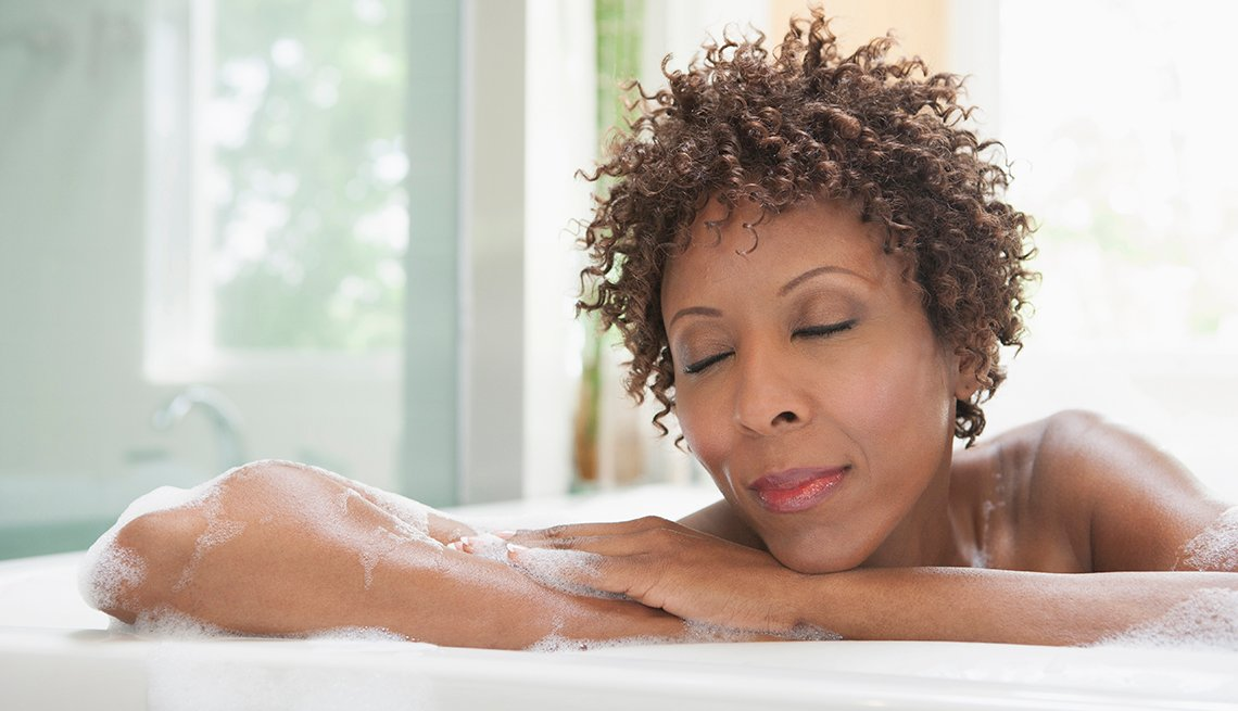 mature woman relaxing in a bath tub
