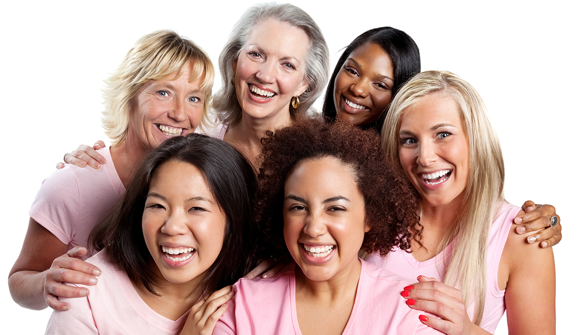 Happy group of diverse women embracing each other.