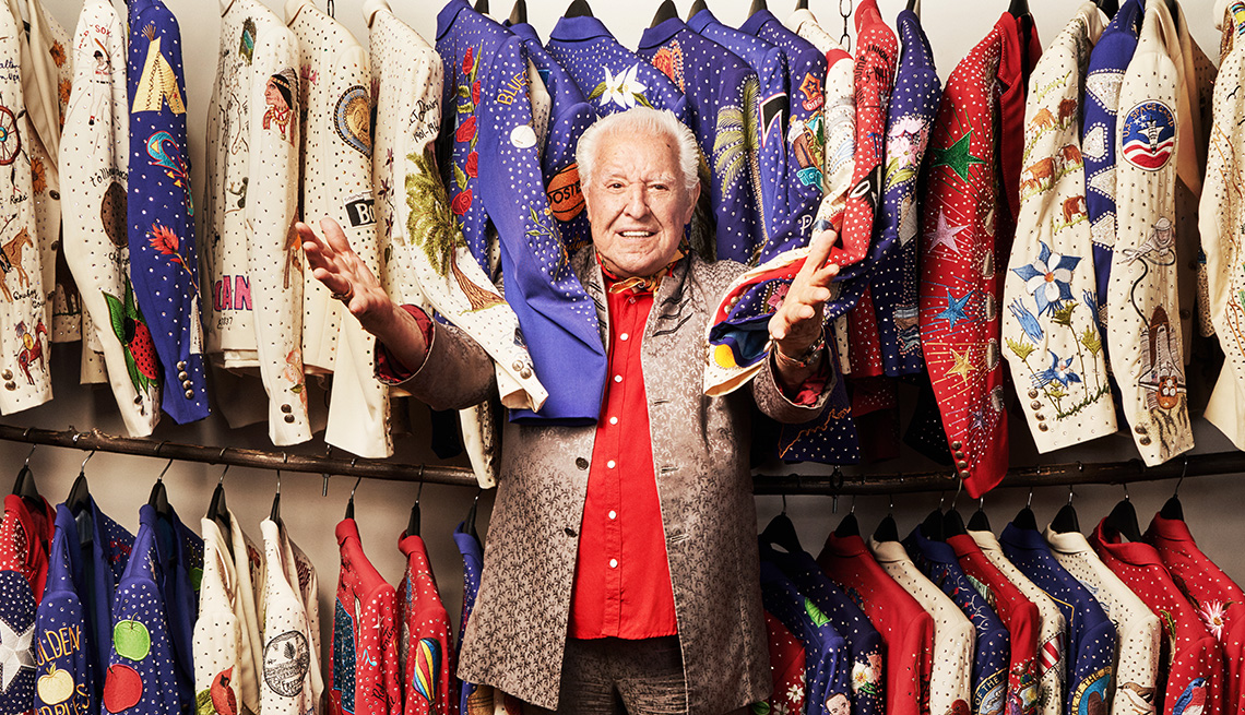 Manuel Cuevas standing in front of clothes