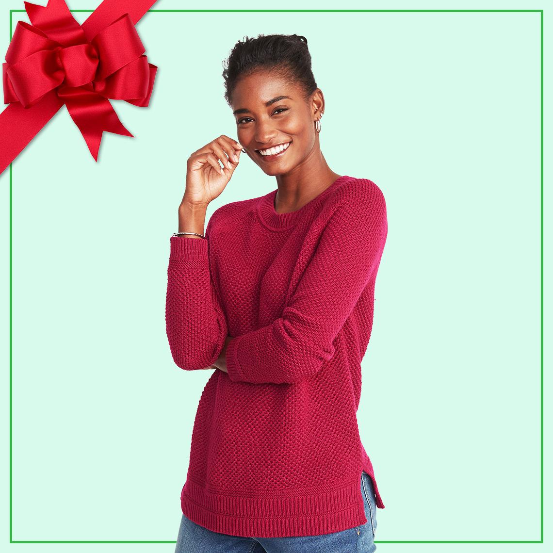 A woman wearing a raspberry sweater