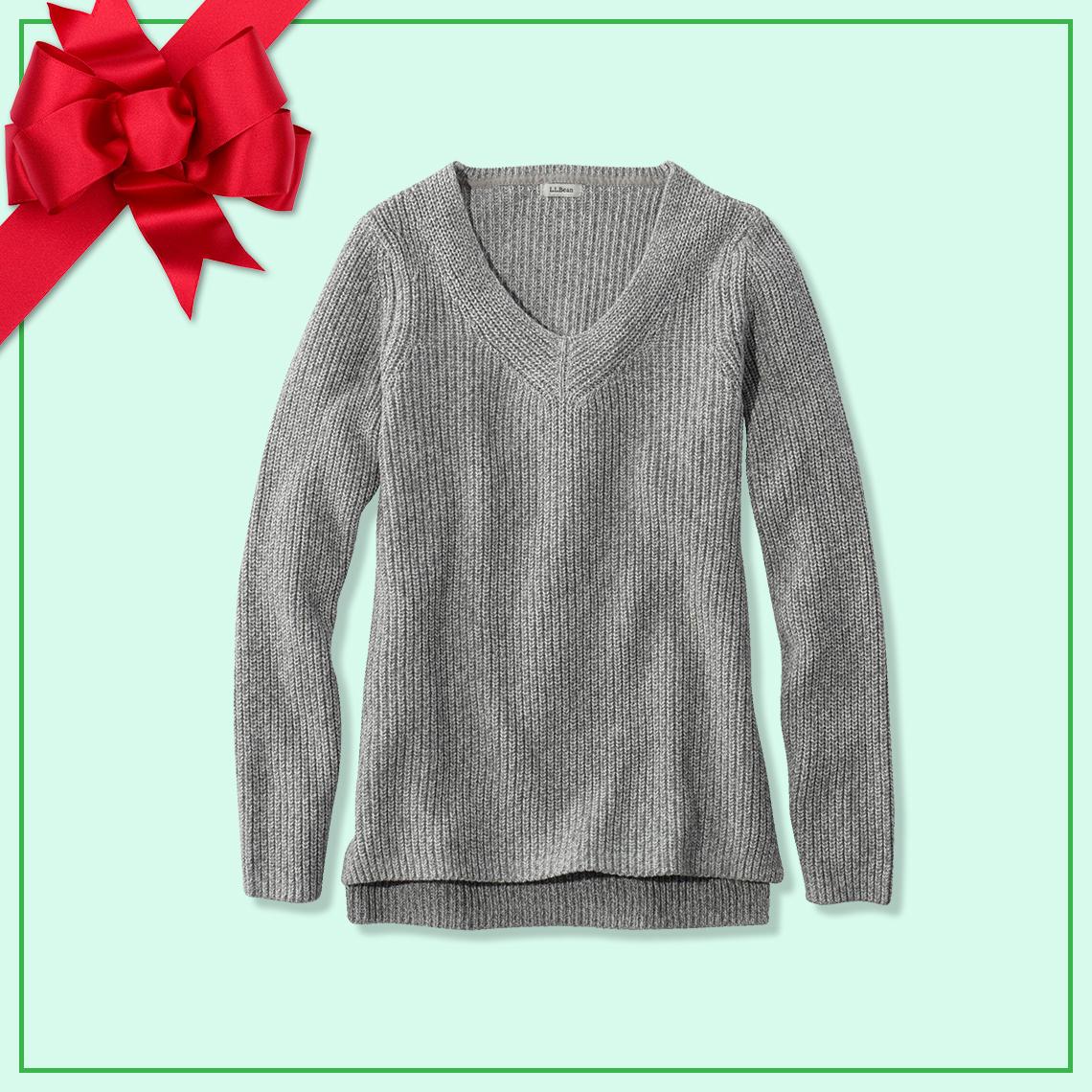 A gray v neck sweater.