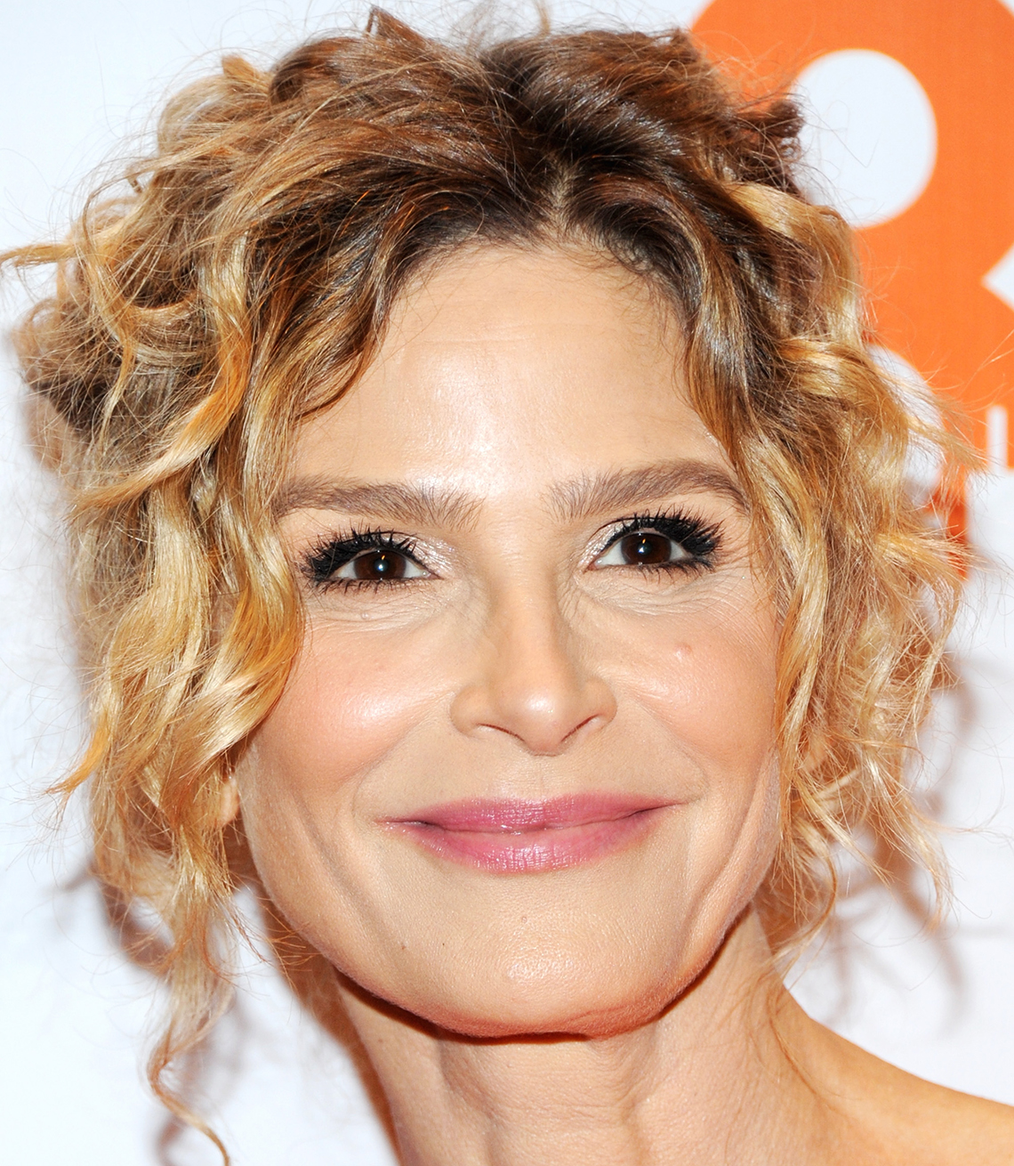 Kyra Sedgwick with brown roots
