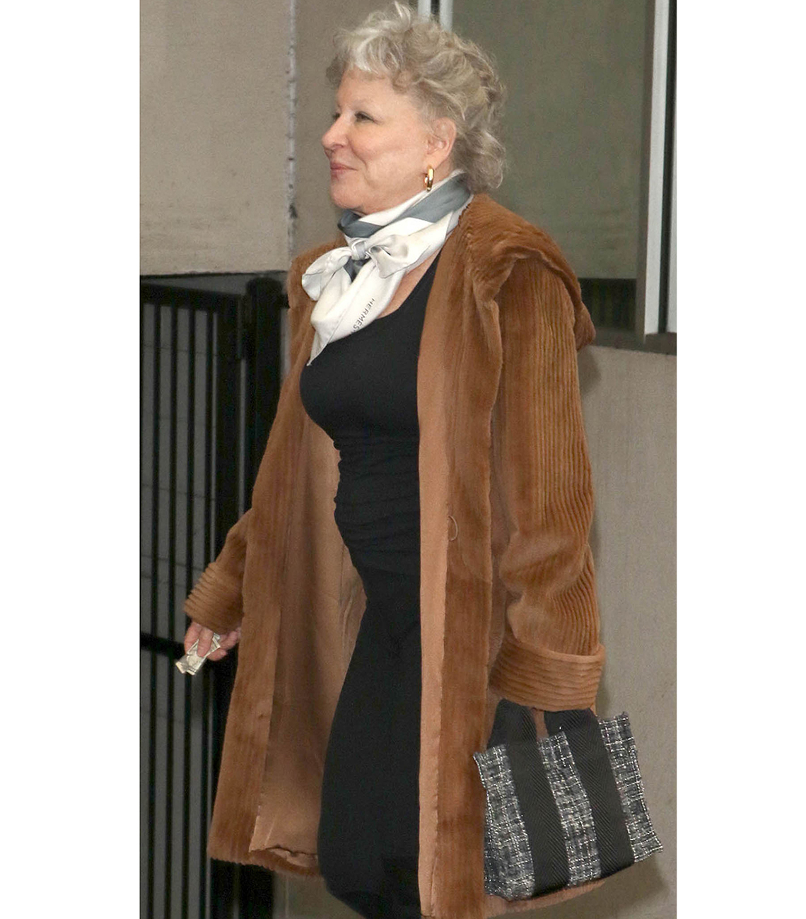 Bette Midler fits all her essentials in a small tote.