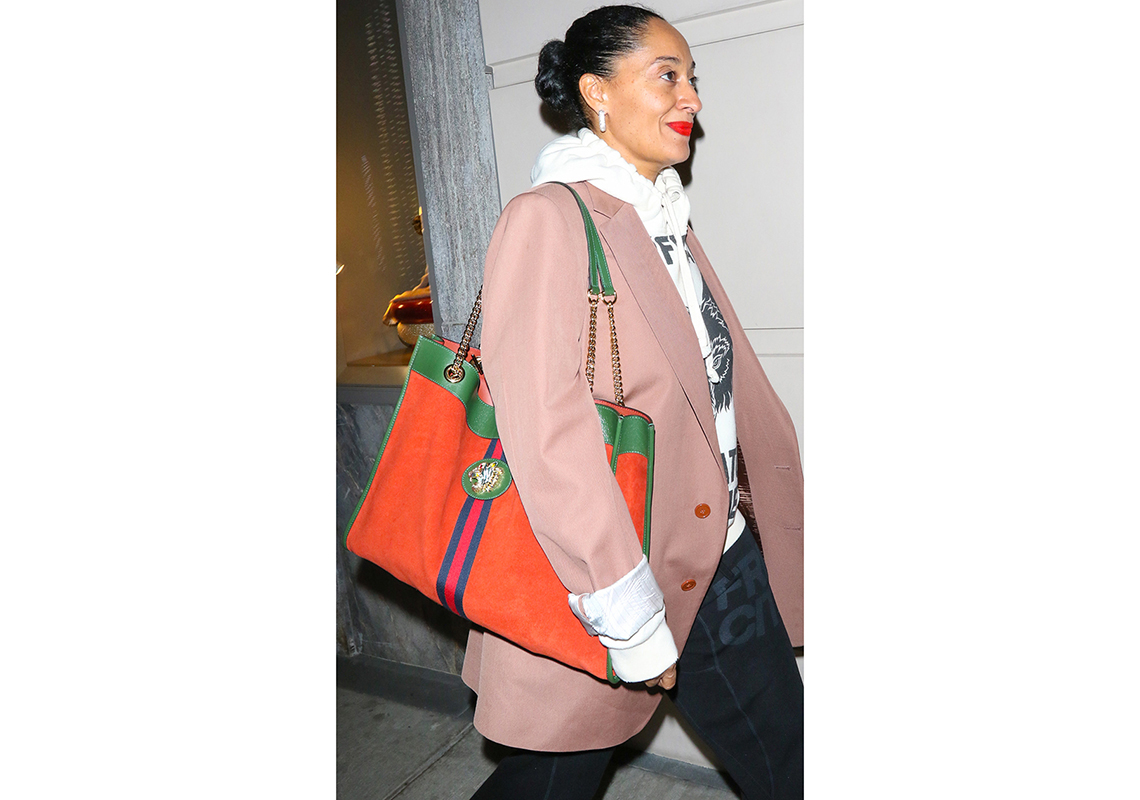 Tracee Ellis Ross slings a chain-strap tote