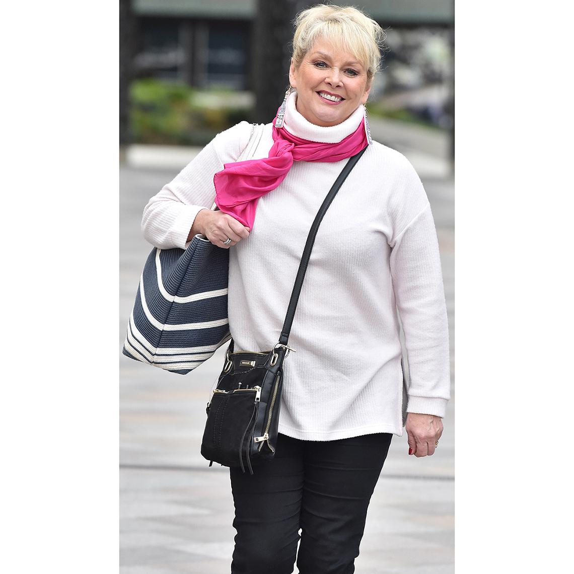 Cheryl Baker with two handbags