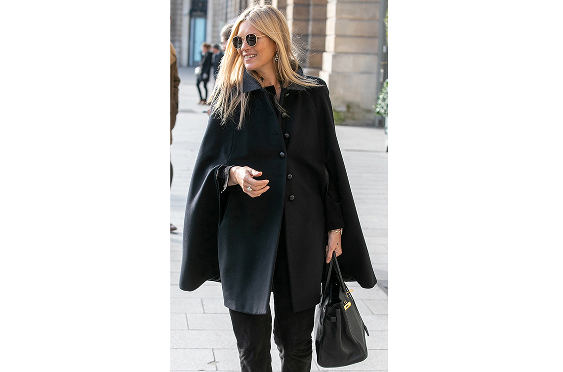 Kate Moss hand-carries a round-handled satchel.