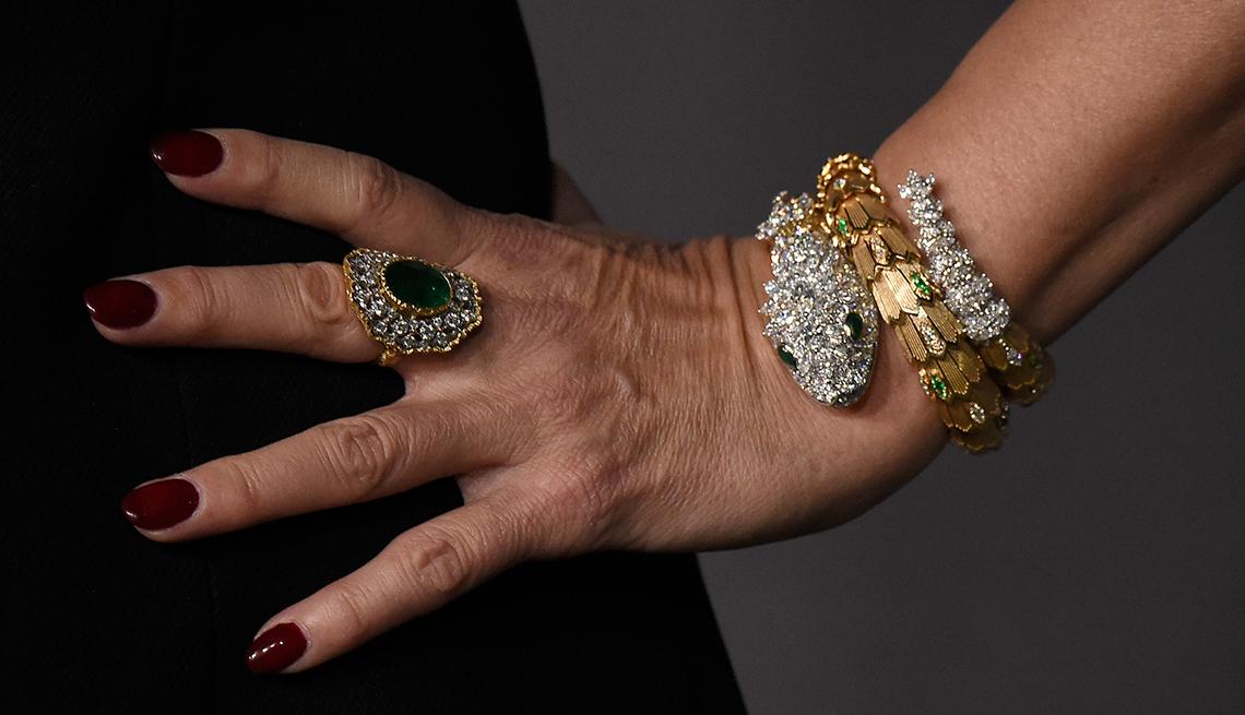 item 8, Gallery image. Jennifer Tilly wears vivid wine-red nails
