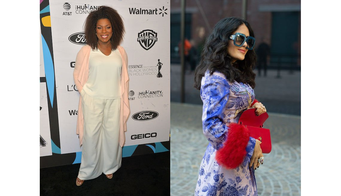 item 1, Gallery image. Lorraine Toussaint in wide white pants and white V-neck top with a long, flowing, pale pink cardigan and Salma Hayek in blue print coat with red fur cuffs, statement green glasses.