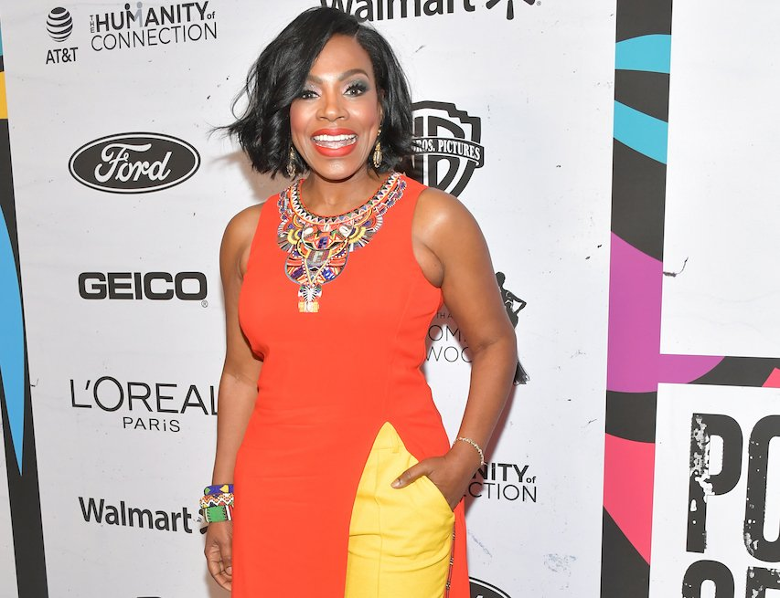 item 7, Gallery image. Sheryl Lee Ralph in orange sleeveless tunic dress over full-cut yellow pants