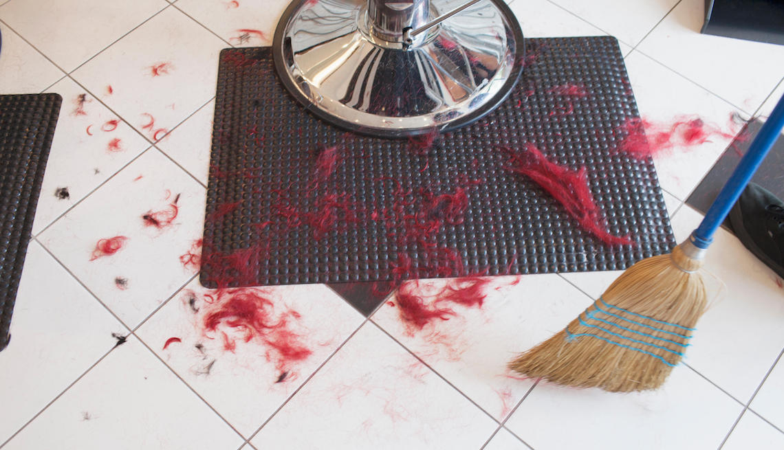 item 11 of Gallery image - The dirty floor of a hair salon.