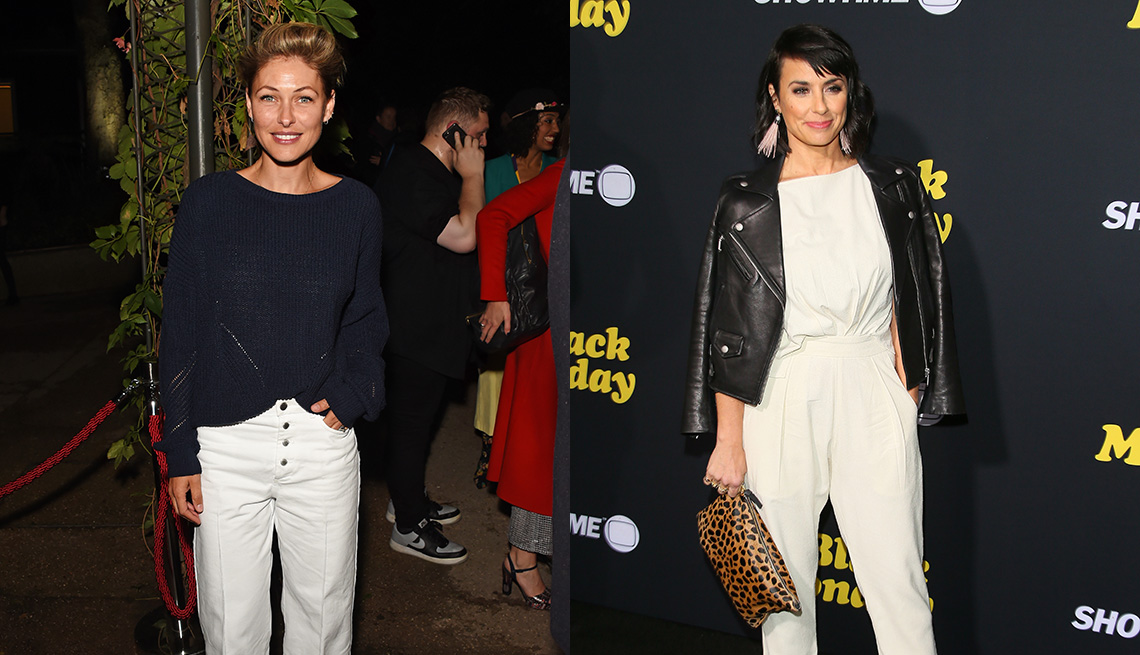 item 2 of Gallery image - Emma Willis  in white loose cropped pants, half-tucked navy sweater, Constance Zimmer in relaxed white tailored ankle pants and white top, black leather biker, leopard bag