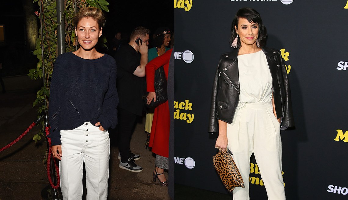 item 2, Gallery image. Emma Willis  in white loose cropped pants, half-tucked navy sweater, Constance Zimmer in relaxed white tailored ankle pants and white top, black leather biker, leopard bag.