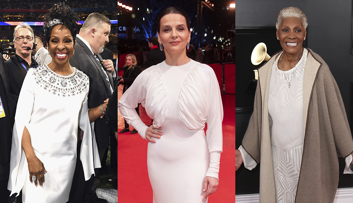 item 9 of Gallery image - Gladys Knight in a white embellished dress with draped slash sleeves, Juliette Binoche in a white gown with draped bodice and dolman sleeves, Dionne Warwick in a white gown and taupe cashmere jacket