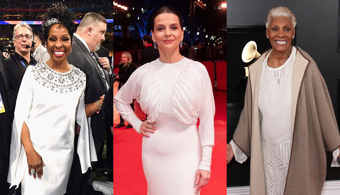item 9, Gallery image. Gladys Knight in a white embellished dress with draped slash sleeves, Juliette Binoche in a white gown with draped bodice and dolman sleeves, Dionne Warwick in a white gown and taupe cashmere jacket.