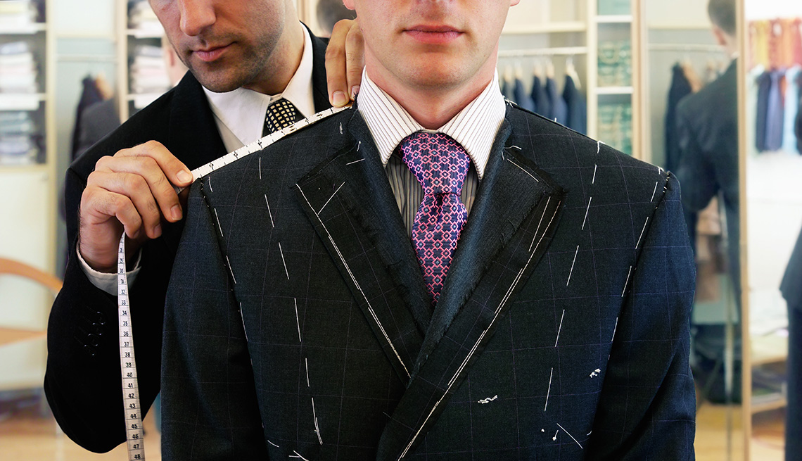 73f14ba9073 Man being fitted for suit by tailor