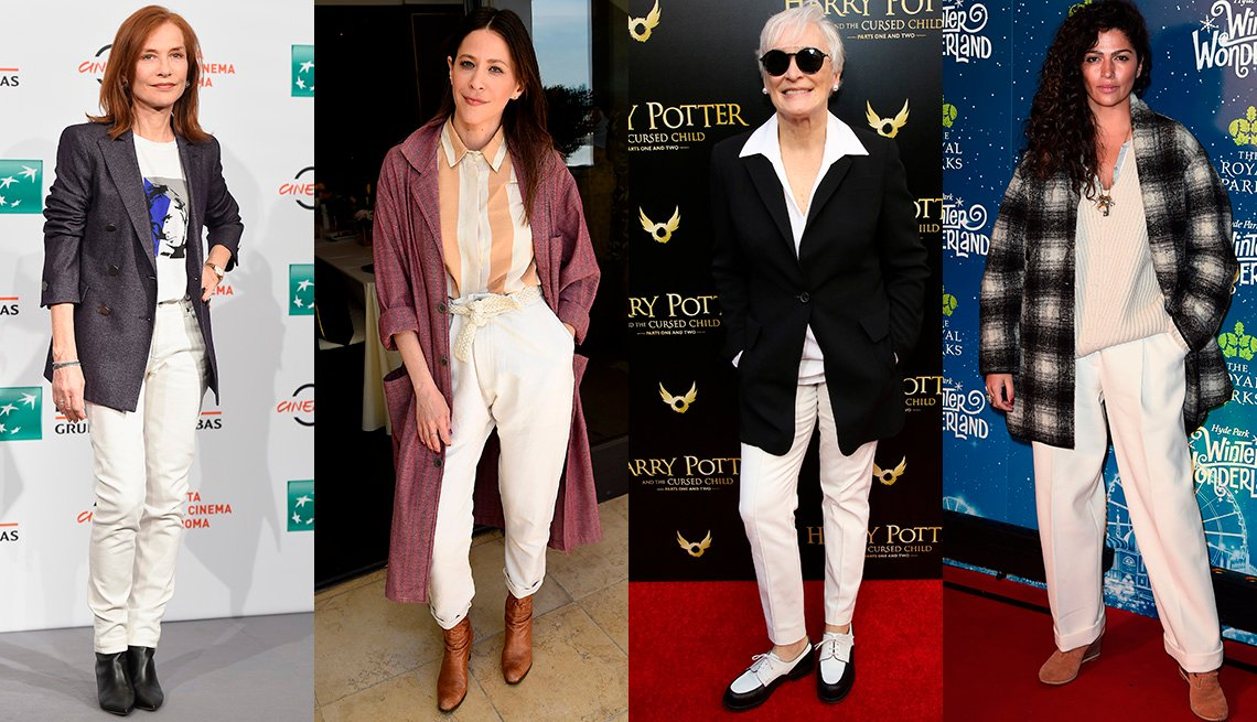 item 7, Gallery image. Isabelle Huppert in white jeans and t-shirt with gray blazer, Jackie Tohn in white pants, striped shirt, plum coat, Glenn Close in white  pants, shirt, Camila Alves McConaughey in white sweater and pants, plaid jacket.