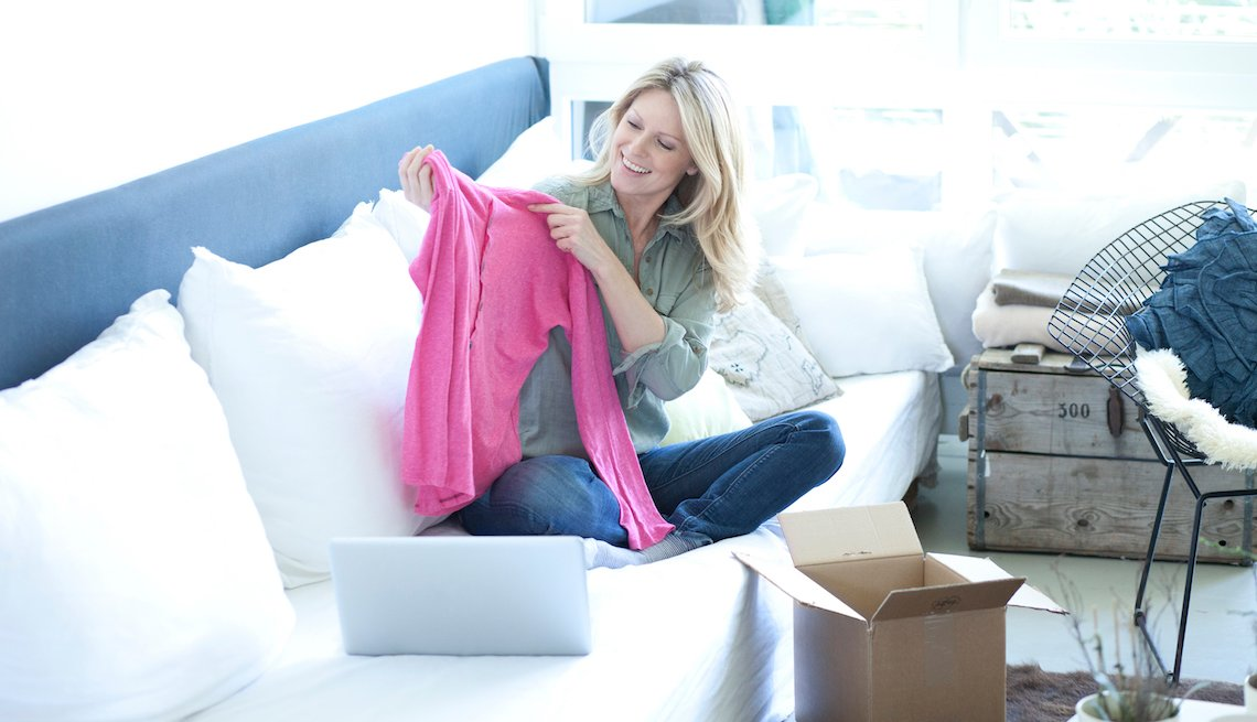 Woman receives a sweater she bought online
