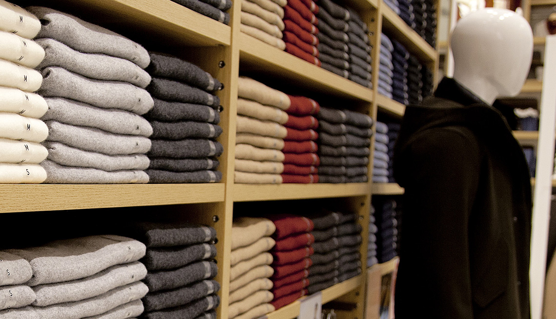 Cashmere clothes are displayed on shelves at Uniqlo