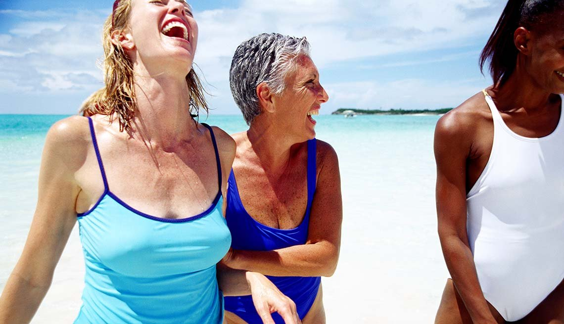 3 women frolic at the beach