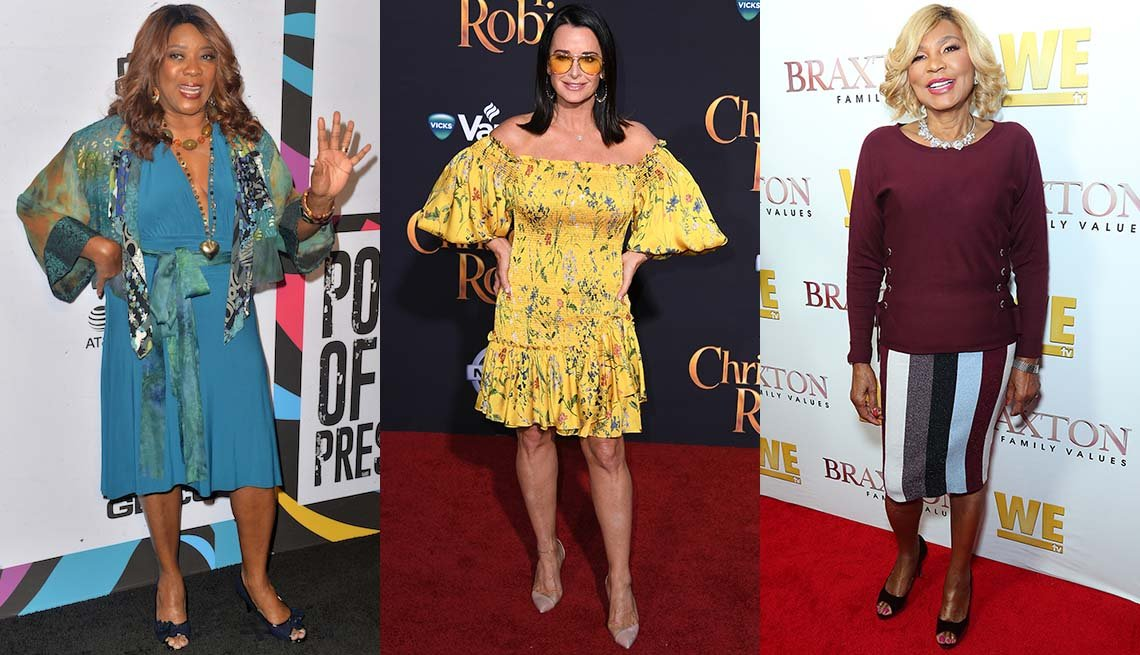 item 8, Gallery image. Loretta Devine in a blue V-neck dress and navy peep-toe pumps; Kyle Richards in yellow print off-shoulder dress, bare legs and nude pumps; Evelyn Braxton in striped knit pencil skirt with peep-toe black pumps.
