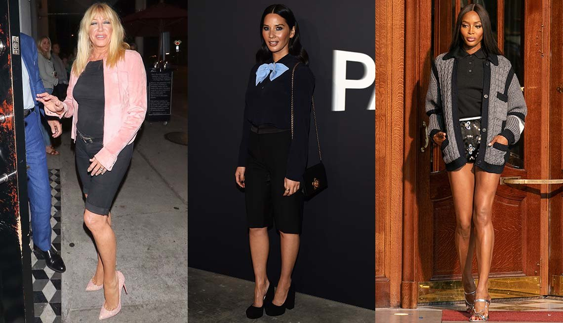 item 9, Gallery image. Suzanne Somers in black shorts and top with a pink cropped jacket; Olivia Munn in black tapered Bermuda's, black blouse and pumps, bare legs.