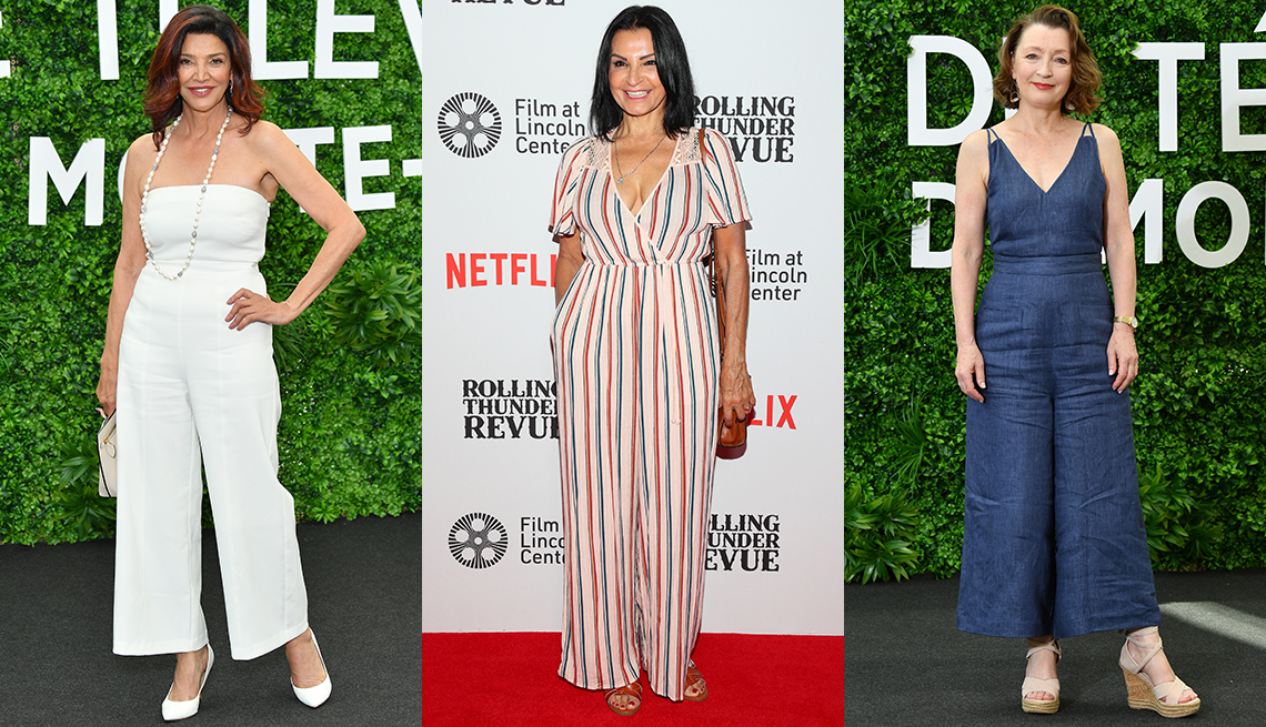item 7 of Gallery image - Shohreh Aghdashloo in white strapless jumpsuit ; Katherine Narducci in a red, white and blue striped jumpsuit; Lesley Manville in s denim jumpsuit and espadrilles