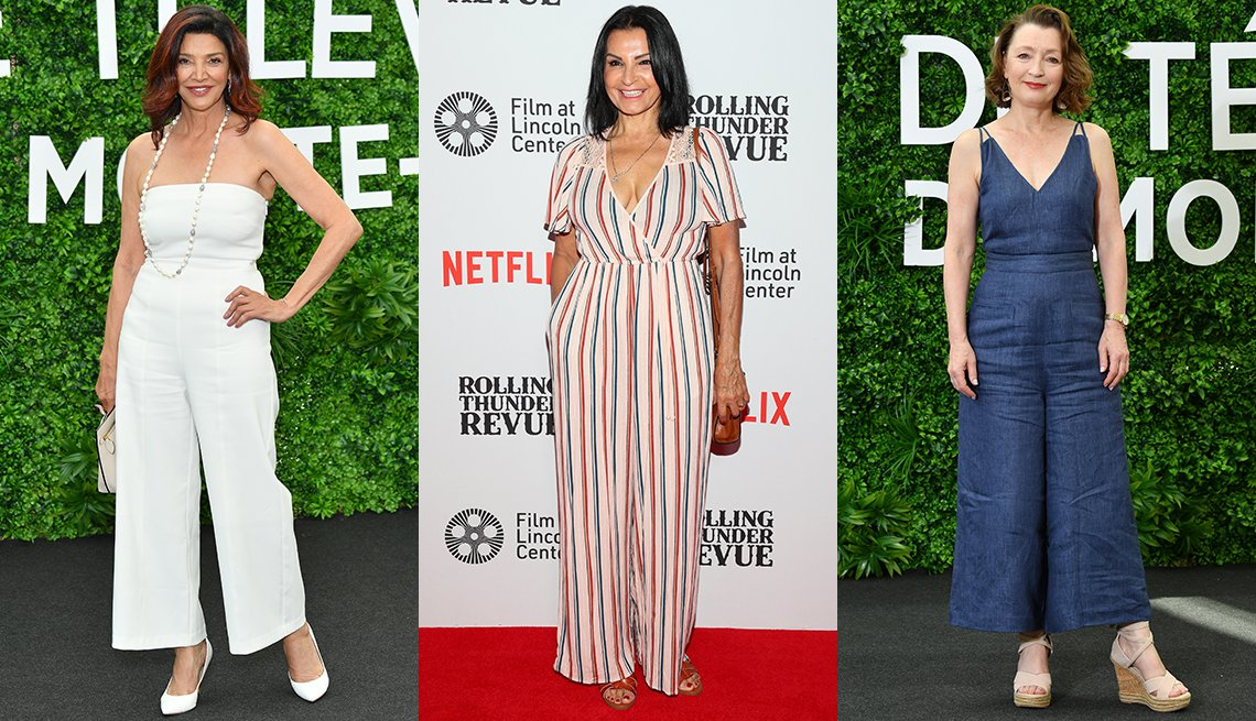 item 7, Gallery image. Shohreh Aghdashloo in white strapless jumpsuit; Katherine Narducci in a red, white and blue striped jumpsuit; Lesley Manville in a denim jumpsuit and espadrilles