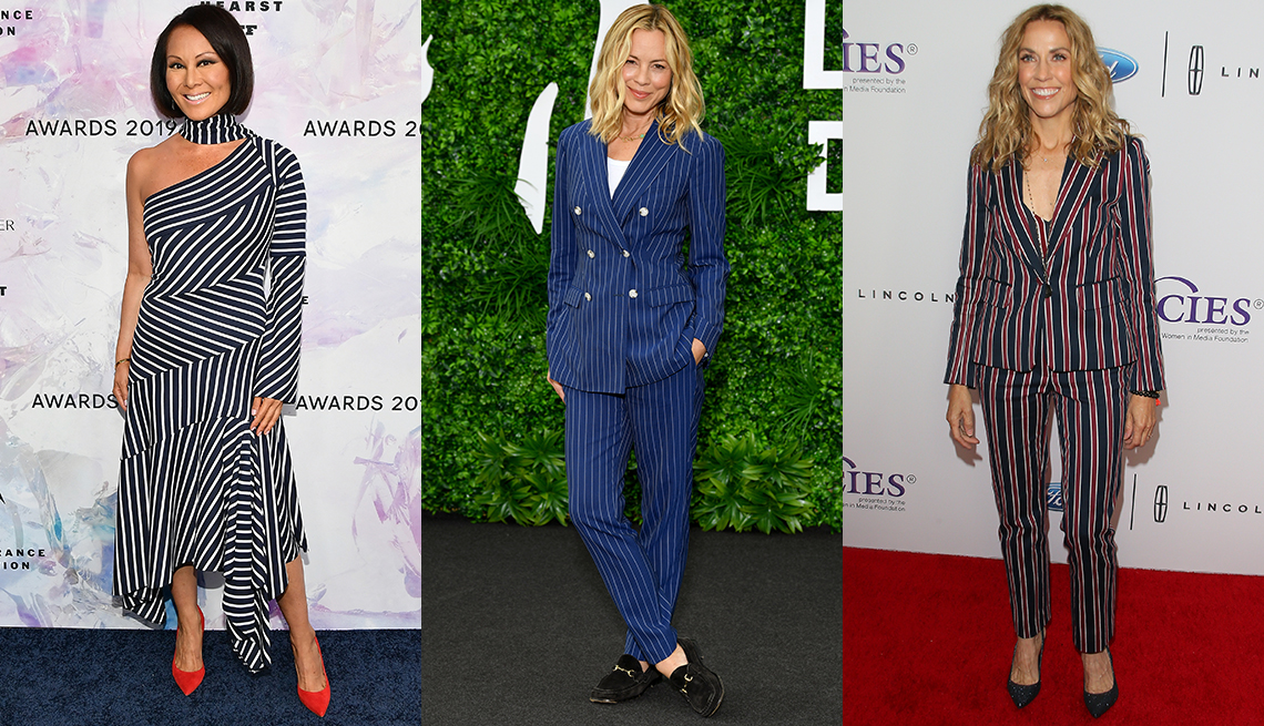 item 10 of Gallery image - Alina Cho in navy and white asymmetric midi dress and red shoes; Maria Bello in navy and white striped db pantsuit over a white tank with loafers; Sheryl Crow in red and navy striped pantsuit