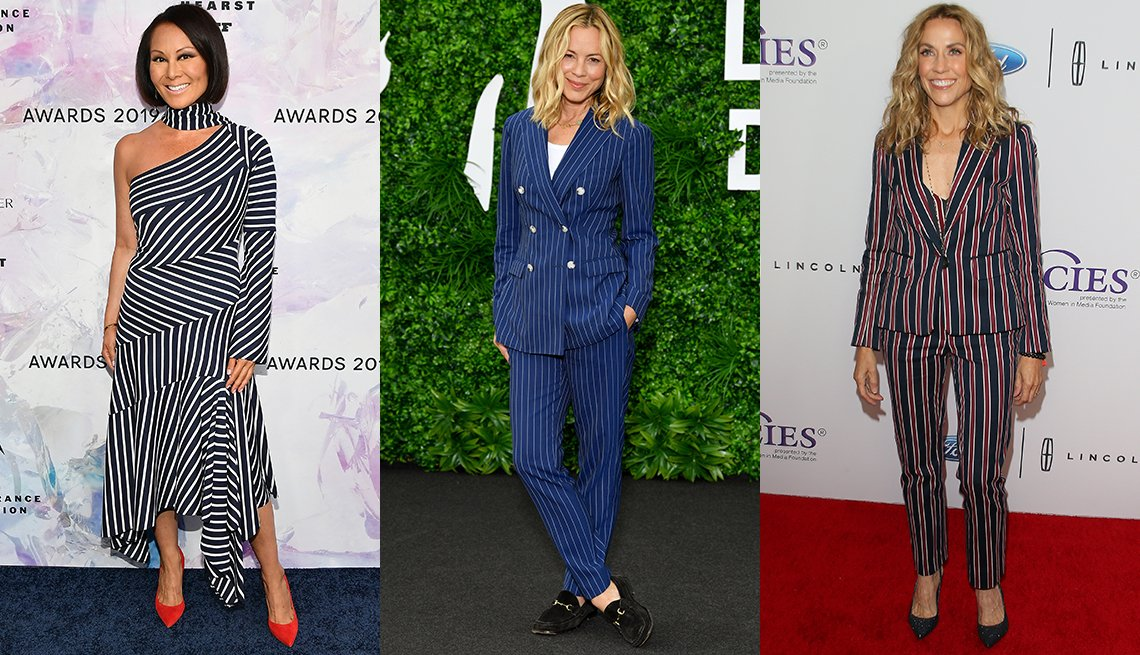item 10, Gallery image. Alina Cho in navy and white asymmetric midi dress and red shoes; Maria Bello in navy and white striped double-breasted pantsuit over a white tank with loafers; Sheryl Crow in red and navy striped pantsuit