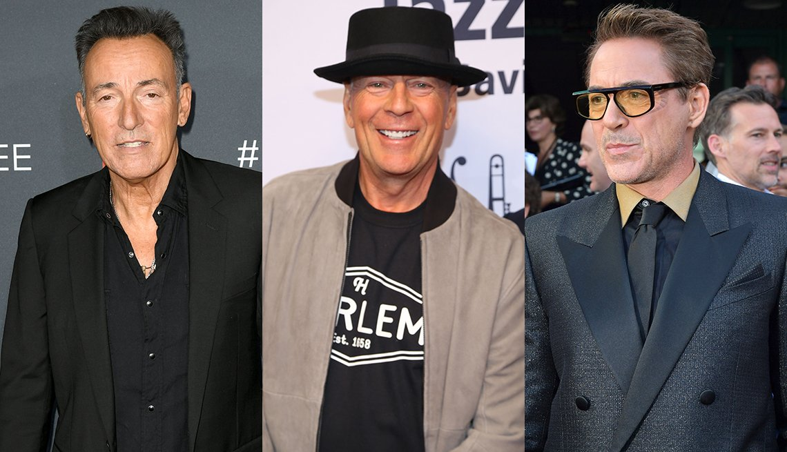 item 18, Gallery image. Bruce Springsteen in black shirt, black blazer; Bruce Willis in black derby hat, beige bomber; Robert Downey Jr in black statement glasses, khaki and black two-tone shirt, black tie and shimmery textured black suit.