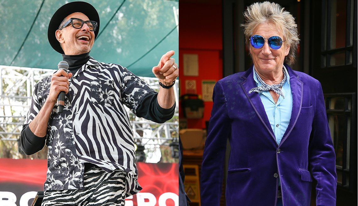 item 9, Gallery image. Jeff Goldblum in fedora and trademark glasses, zebra and floral print shirt over a black turtleneck with zebra pants; Rod Stewart in purple velvet blazer over light blue shirt with neckerchief, blue sunglasses and blue jeans.