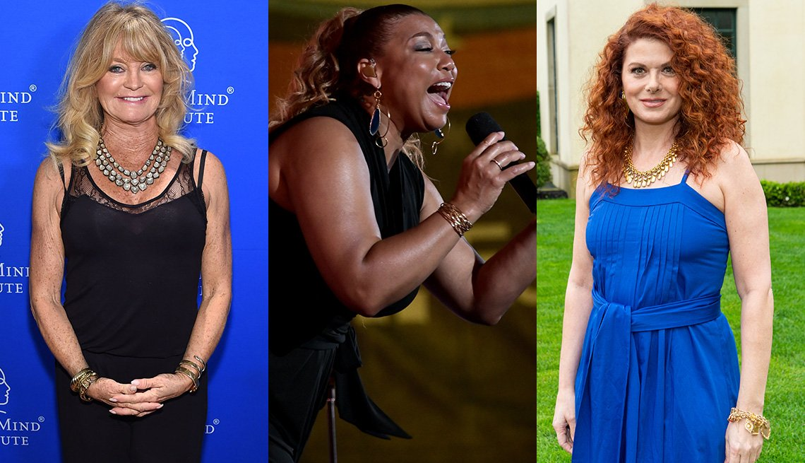 item 1, Gallery image. Goldie Hawn in black sleeveless illusion blouson tank and black pants; Queen Latifah in sleeveless black jumpsuit; Debra Messing shows her right to bare arms in a bright blue sundress